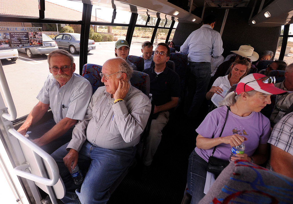 . Members of the Lahontan Regional Water Quality Control Board Don Jardine, left, and Peter Pumphrey, center left, take a PG&E tour to learn more about a Whole House Water system at an agriculture unit in Hinkley June 13, 2012.  GABRIEL LUIS ACOSTA/STAFF PHOTOGRAPHER.