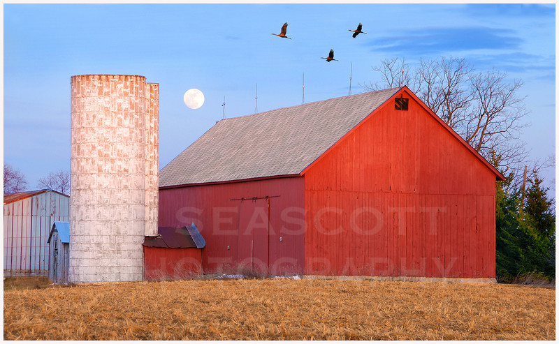 Moonrise over SE Michigan Land Conservancy farm buildings.