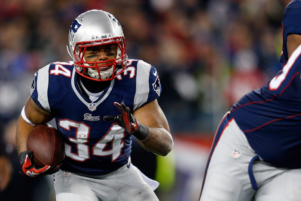 . Shane Vereen #34 of the New England Patriots runs the ball against the Baltimore Ravens during the 2013 AFC Championship game at Gillette Stadium on January 20, 2013 in Foxboro, Massachusetts.  (Photo by Jim Rogash/Getty Images)