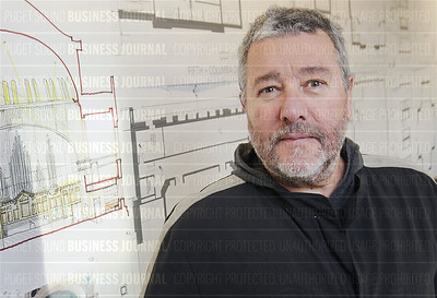 World-reknown French designer Philippe Starck is pictured next to some of his artwork for the in-development SLS Hotel in Seattle, Washington