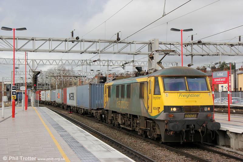 Powerhaul liveried 90045 passes Stafford with 4L90,  1230 Crewe to Felixstowe on 28th January 2014.