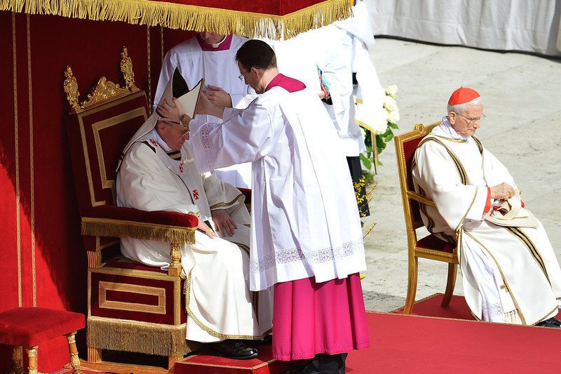 . Pope Francis (L) puts the mitre on during the Easter celebrations on St Peter\'s square on March 31, 2013 at the Vatican. Easter Sunday celebrates the Christian belief in Jesus\'s death and resurrection and is marked around the world, often with a variety of not strictly religious local traditions like painted eggs or Easter Bunnies.   VINCENZO PINTO/AFP/Getty Images