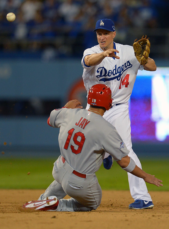 . The Cardinals\' Jon Jay is forced out at 2nd as the Dodgers\' Mark Ellis throws to 1st for a double play in the 6th during game 4 of the NLCS at Dodger Stadium Tuesday, October 15, 2013. (Photo by Andy Holzman/Los Angeles Daily News)