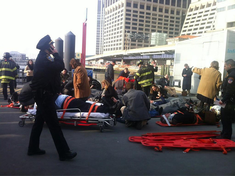 . More than 20 people were sitting or laying on the dock following a hard landing of Seastreak Wall Street ferry as it arrived in Manhattan around 8:45 a.m. Wednesday. Julie Westfall/Digital First Media