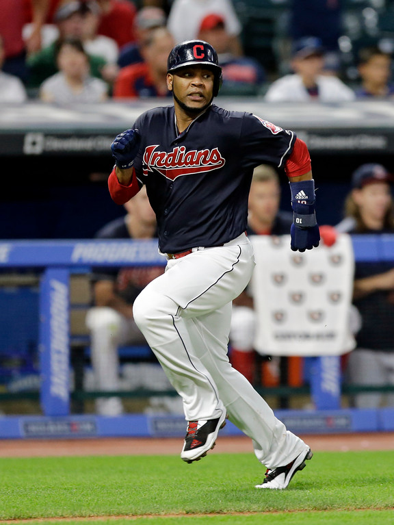 . Cleveland Indians\' Edwin Encarnacion runs home on Jose Ramirez\'s RBI-single in the sixth inning of a baseball game against the San Diego Padres, Thursday, July 6, 2017, in Cleveland. (AP Photo/Tony Dejak)