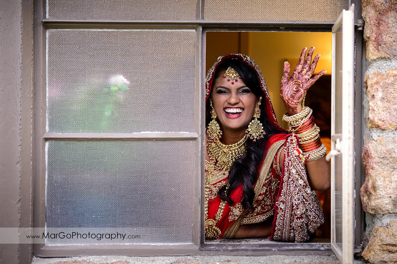 bride in the window in red indian dress at Brazilian Room - Tilden Regional Park, Berkeley