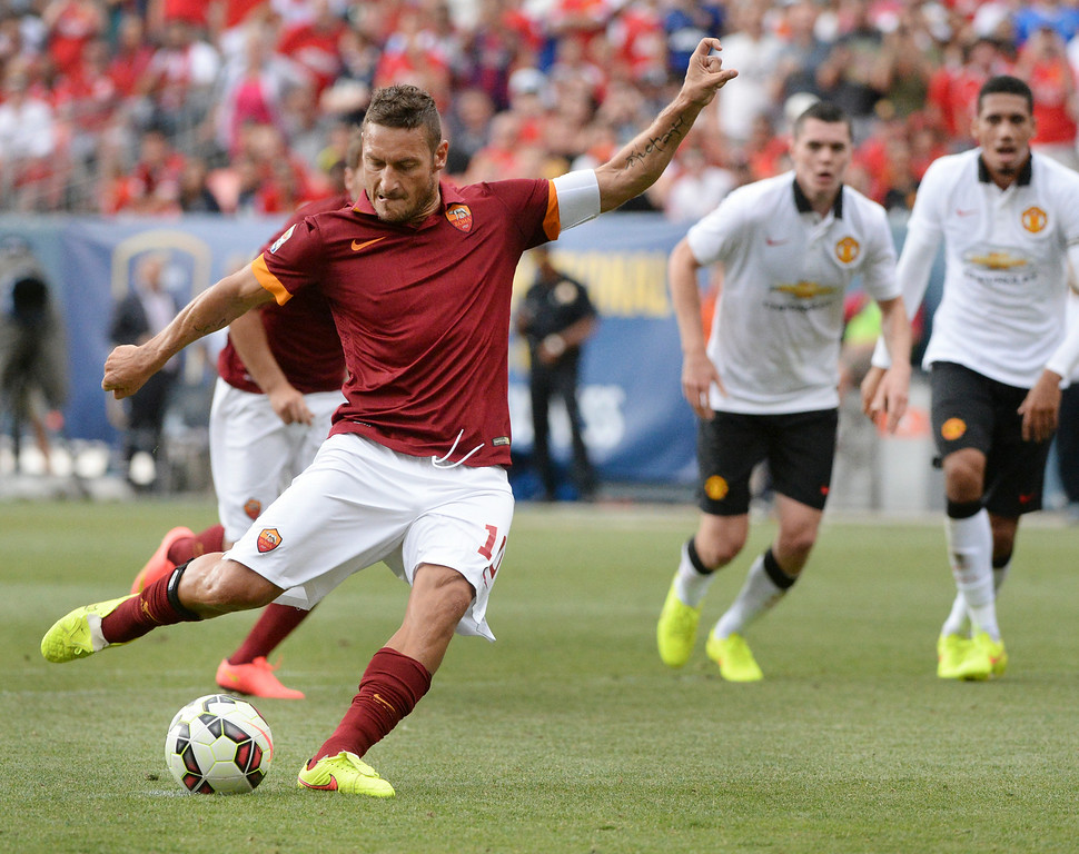 . AS Roma forward Francesco Totti converted a penalty kick after a hand ball was called in the box in the second half. Manchester United defeated AS Roma 3-2 in an exhibition soccer game at Sports Authority Field in Denver Saturday afternoon, July 27, 2014. Photo by Karl Gehring/The Denver Post