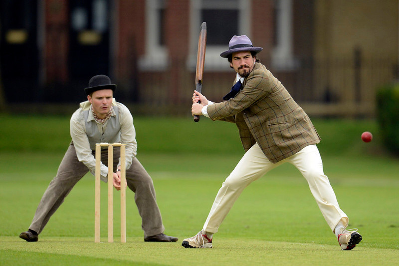 . Author Charlie Campbell (R) prepares to hit the ball during a Victorian Cricket match to commemorate the 150th anniversary of Wisden Cricketers\' Almanack  at Vincent Square in London May 29, 2013. REUTERS/Philip Brown