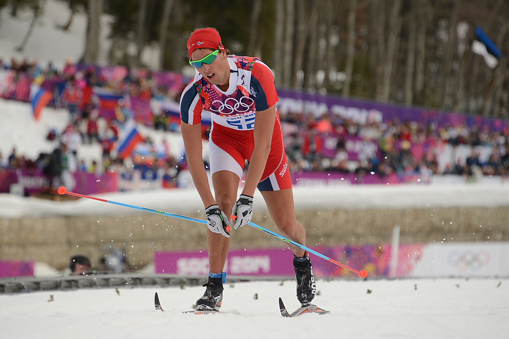 . Norway\'s Chris Andre Jespersen cross the finish line in the Men\'s Cross-Country Skiing 15km Classic at the Laura Cross-Country Ski and Biathlon Center during the Sochi Winter Olympics on February 14, 2014 in Rosa Khutor near Sochi.  The tough men\'s 15 km classic time trial saw apparel not usually associated with skiing, with many competitors wearing just T-shirts instead of the normal long-sleeves while others even bared their legs. AFP PHOTO / KIRILL KUDRYAVTSEV/AFP/Getty Images