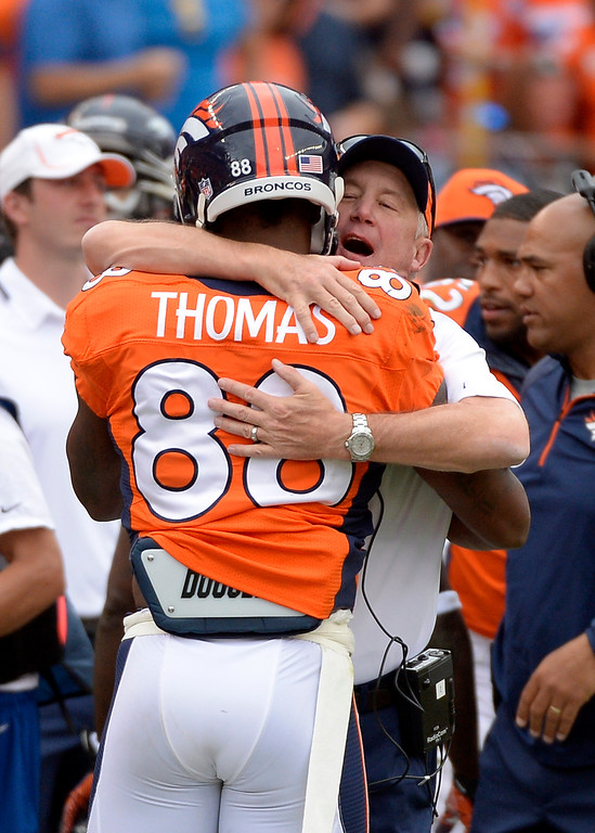 . Denver Broncos head coach John Fox hugs wide receiver Demaryius Thomas (88) during the third quarter.  (Photo by Joe Amon/The Denver Post)