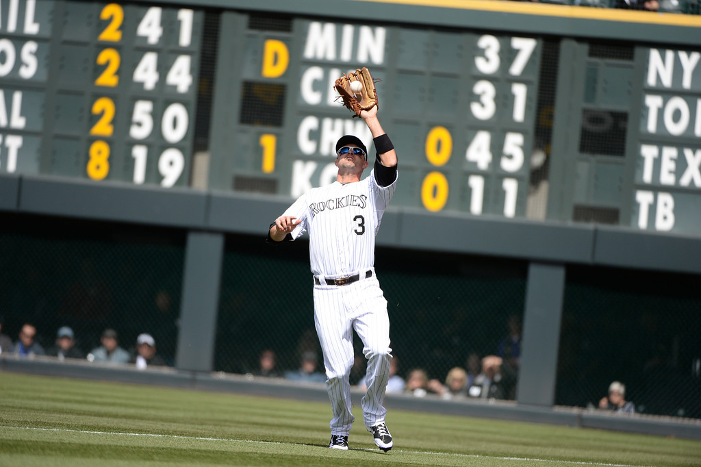 . Colorado Rockies outfielder Michael Cuddyer catches a ball hit by the Arizona Diamondbacks\' Martin Prado during the first inning. (Photo by Hyoung Chang/The Denver Post)
