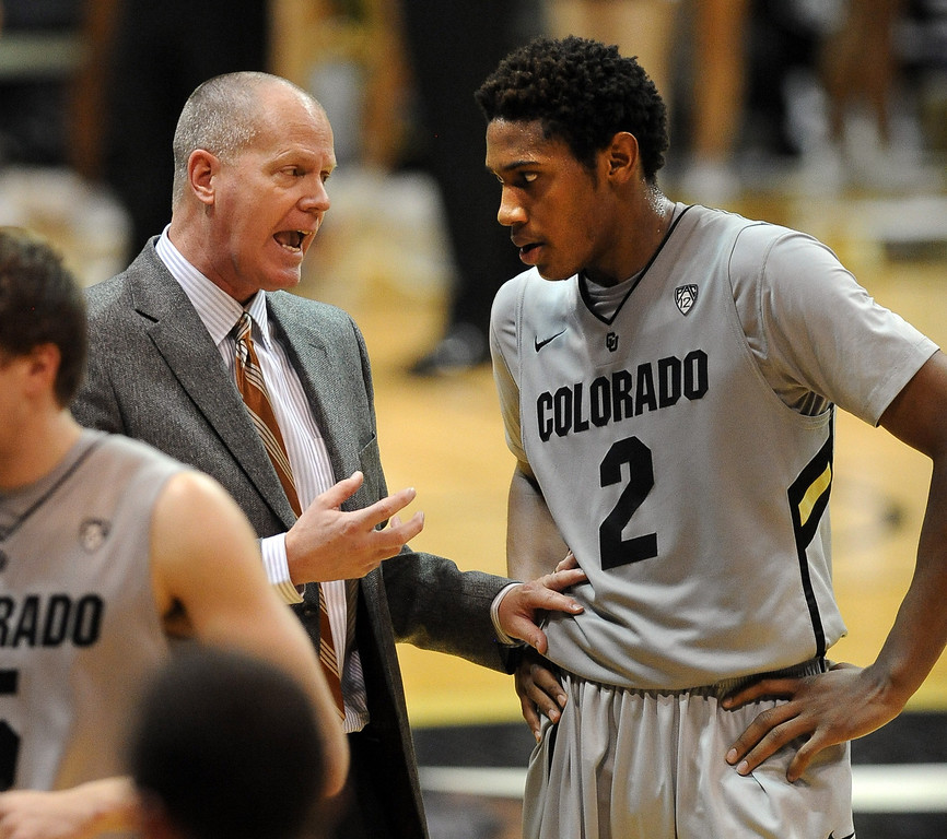 . CU Coach Tad Boyle talks to Xavier Johnson during the second  half of the January 27th, 2013 game in Boulder. Cliff Grassmick/The Daily Camera
