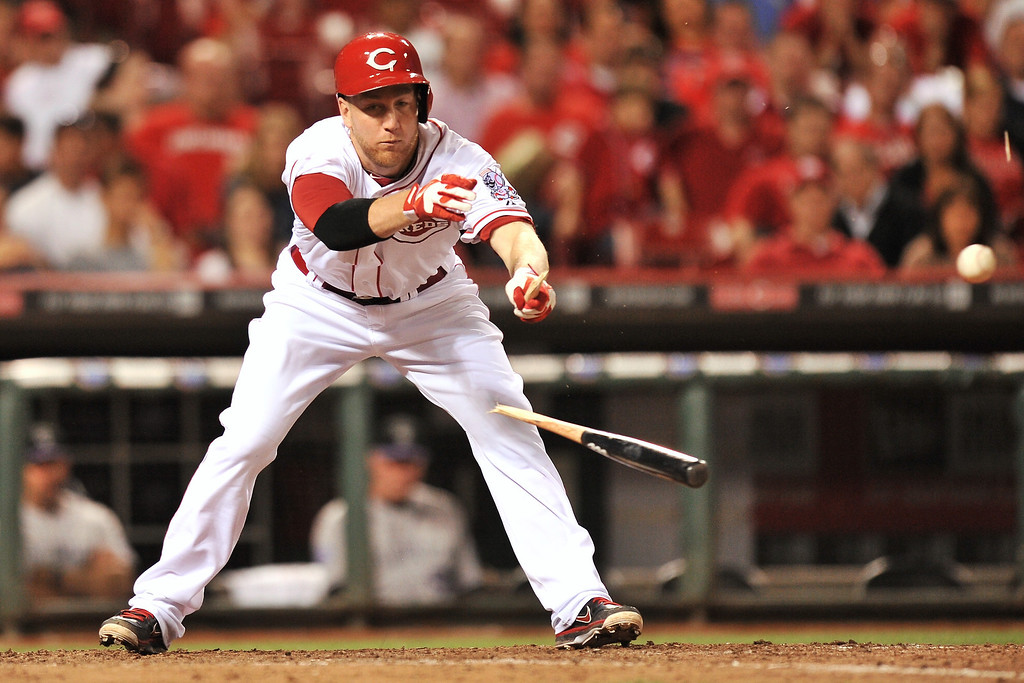 . Todd Frazier #21 of the Cincinnati Reds breaks his bat on a ground out in the eighth inning against the Colorado Rockies at Great American Ball Park on June 4, 2013 in Cincinnati, Ohio. Colorado defeated Cincinnati 5-4.  (Photo by Jamie Sabau/Getty Images)