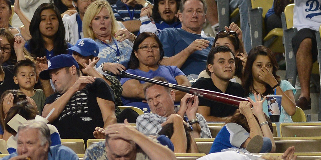 . Fans attempt to protect themselves from the Dodgers\' Hanley Ramirez\'s #13 bat after it fly out of his hands and in to the stands during their game against the Rockies  at Dodgers Stadium Saturday, September 28, 2013. (Photo by Hans Gutknecht/Los Angeles Daily News)