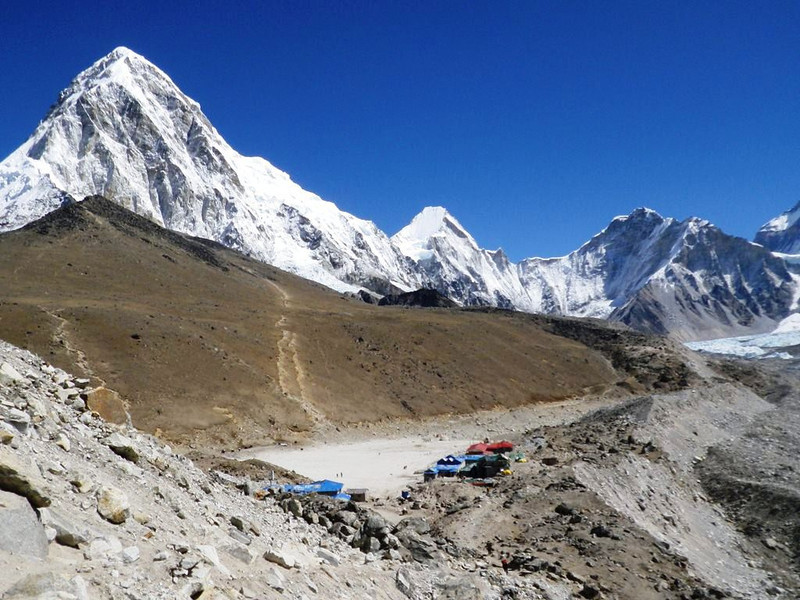 Gorak Shep (16,864ft = 5.140m) the last / highest village in Khumbu Valley. On The horizon from the left: Pumori (23,507ft = 7.165m), Lingtren (22,027ft = 6.714m), and Khumbutse (21,771ft = 6.636m). To the right on Khumbu glacier Everest BC can be seen.