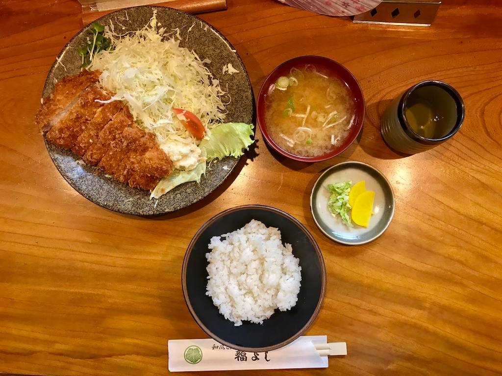 The total set: pork cutlet, rice, miso soup, pickles, tea.