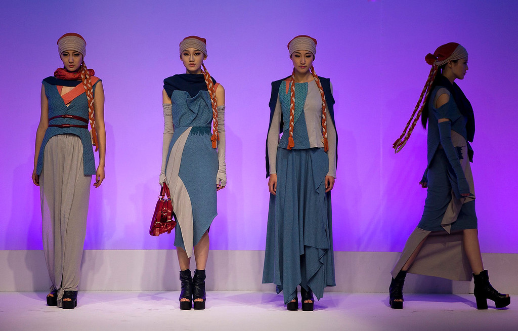 . Models present creations on stage by Chinese designer Gao Lei during the Huafu Cup fashion design contest at the China Fashion Week in Beijing Monday, Oct. 28, 2013. (AP Photo/Andy Wong)