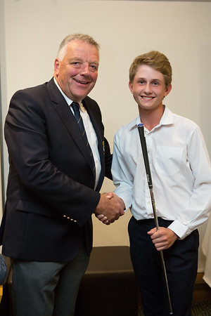 Stepehn Kenny, Junior Boys Winner of The Captain's Prize, being congratulated by Peter