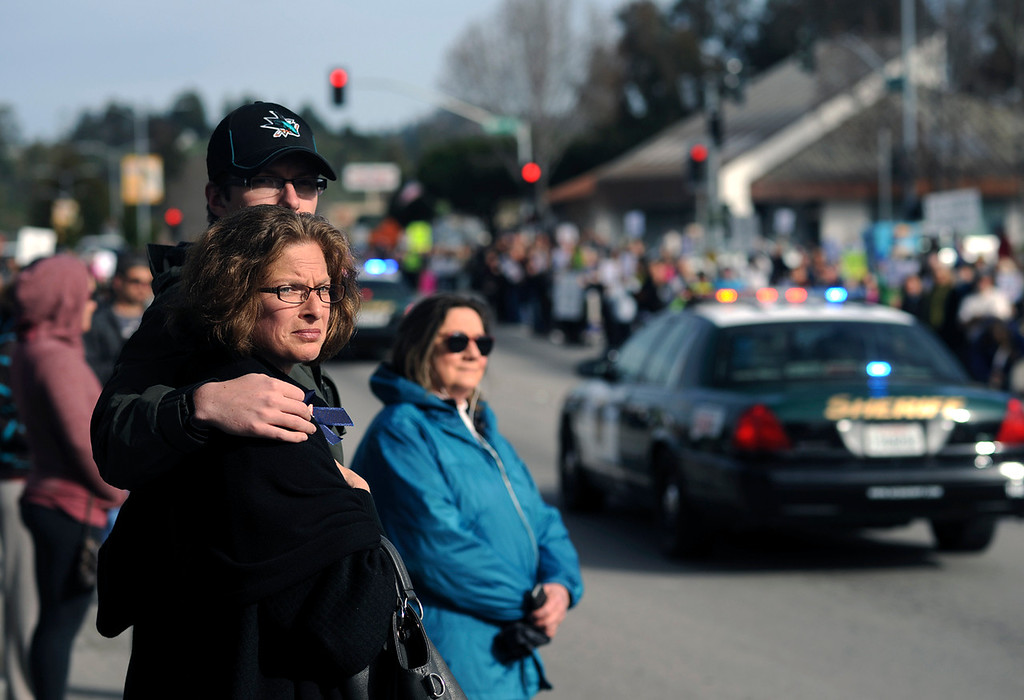 ". Santa Cruz residents watch the funeral procession for detectives Sgt. Loran ""Butch\"" Baker and Elizabeth Butler along Ocean Street in Santa Cruz, Calif., as nearly 200 squad cars make their way toward Highway 17 North on Thursday, March 7, 2013. (Matthew Hintz/Santa Cruz Sentinel)"
