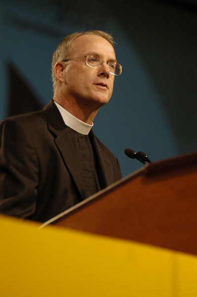 Pr. Michael L. Burk speaks to the assembly.