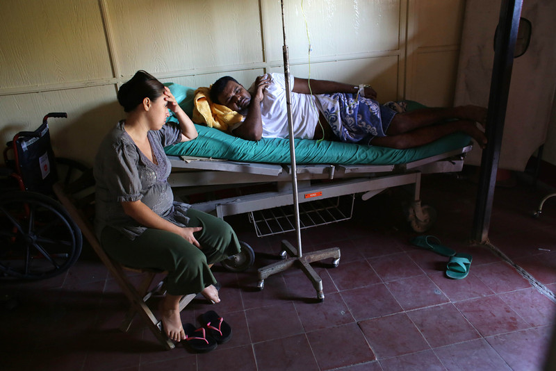. A woman tends her husband, injured during an earthquake on the eve, at hospital in Nagarote, some 40 Km from Managua, on April 11, 2014. A 6.2-magnitude earthquake that struck Nicaragua killed one person, left 33 injured and damaged more than 800 homes, the government said Friday.  (Inti Ocon/AFP/Getty Images)