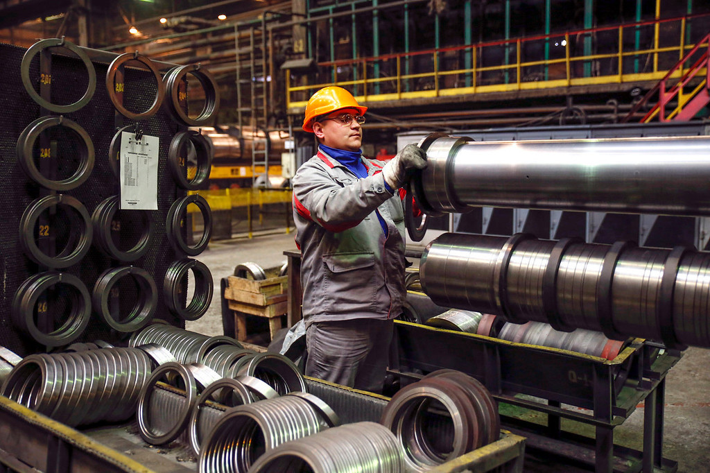. An employee carries out a quality control check on steel material in the rolling mill shop at the Zaporizhstal steel plant, owned and operated by Metinvest BV at their site in Zaporizhzhya, Ukraine, on Tuesday, Oct. 15, 2013. Metinvest BV, Ukraine\'s largest steelmaker, last year acquired 49.9% in steelmaker Zaporizhstal a manufacturer of semi-finished steel products, including hot and cold-rolled plates and coils. Photographer: Vincent Mundy/Bloomberg