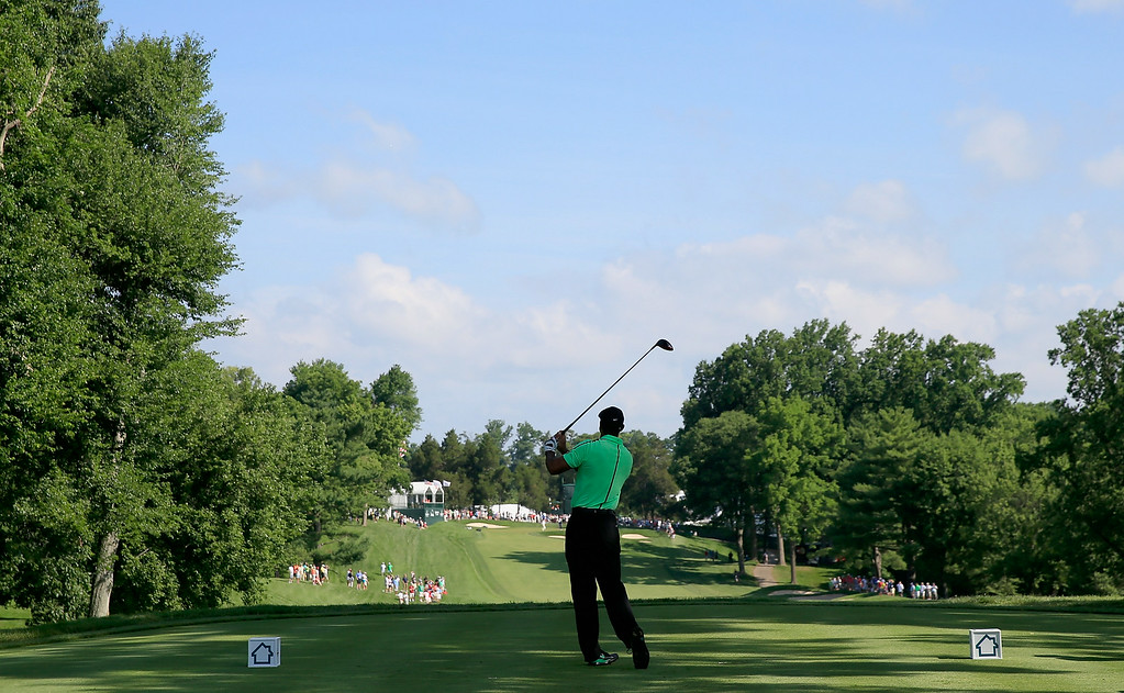 . BETHESDA, MD - JUNE 26:  Tiger Woods of the United States watches his tee shot on the 15th hole during the first round of the Quicken Loans National at Congressional Country Club on June 26, 2014 in Bethesda, Maryland.  (Photo by Rob Carr/Getty Images)