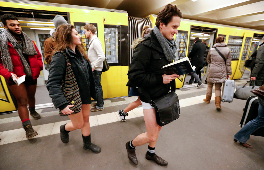 ". People without their pants exit a subway train during the ""No Pants Subway Ride\"" in Berlin January 13, 2013. The event, organised by Improv Everywhere, involves participants who strip down to their underwear as they go about their normal routine. REUTERS/Fabrizio Bensch (GERMANY)"