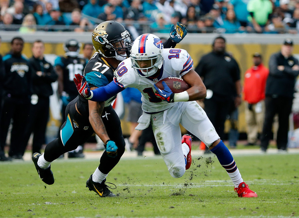 . Dwayne Gratz #27 of the Jacksonville Jaguars attempts to tackle  Robert Woods #10 of the Buffalo Bills during the game at EverBank Field on December 15, 2013 in Jacksonville, Florida.  (Photo by Sam Greenwood/Getty Images)