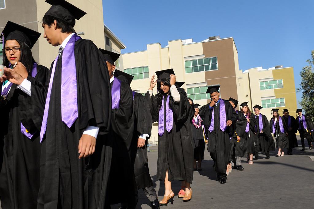 . Graduates walk through the Cesar Chavez Learning Academies campus for the Social Justice Humanitas Academy graduation in San Fernando, Wednesday, June 5, 2013. (Michael Owen Baker/Staff Photographer)