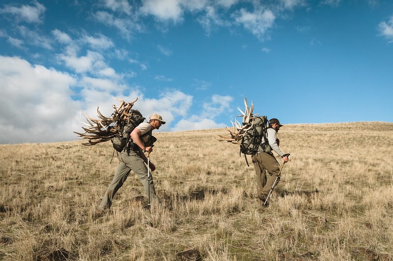 Casey Barton (_caseybarton_) and Sam Averett (samaverett) with elk antlers in Oregon.