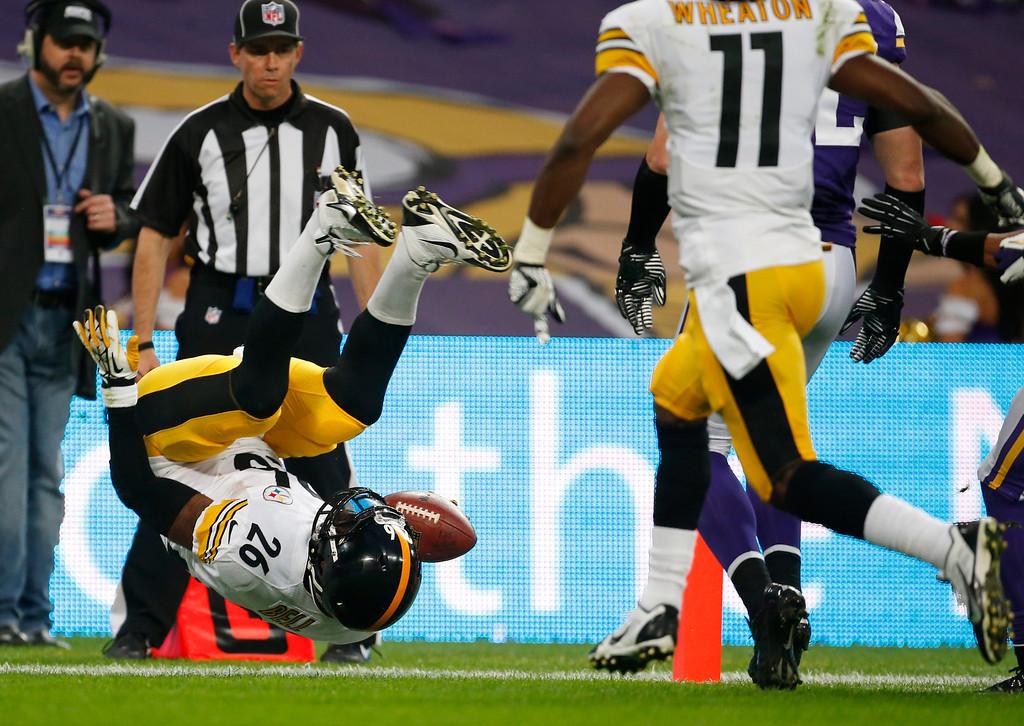 . Pittsburgh Steelers running back Le\'Veon Bell flips over as he scores on an eight-yard touchdown run during the NFL football game against Minnesota Vikings at Wembley Stadium, London, Sunday, Sept. 29, 2013. (AP Photo/Matt Dunham)