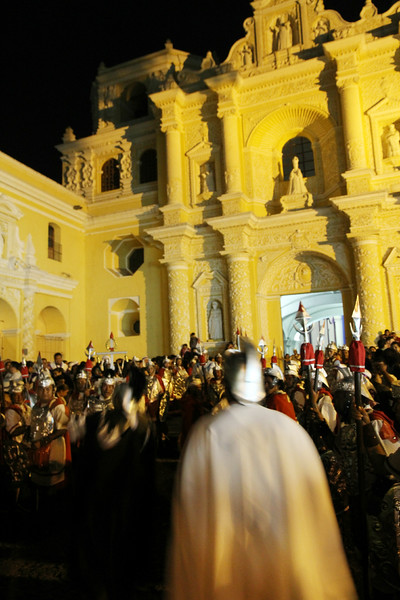 Roman soldiers await the arrival of the final display to arrive at Iglesia La Merced in Antigua, Guatemala on March 24, 2013. Photo by Scott Umstattd