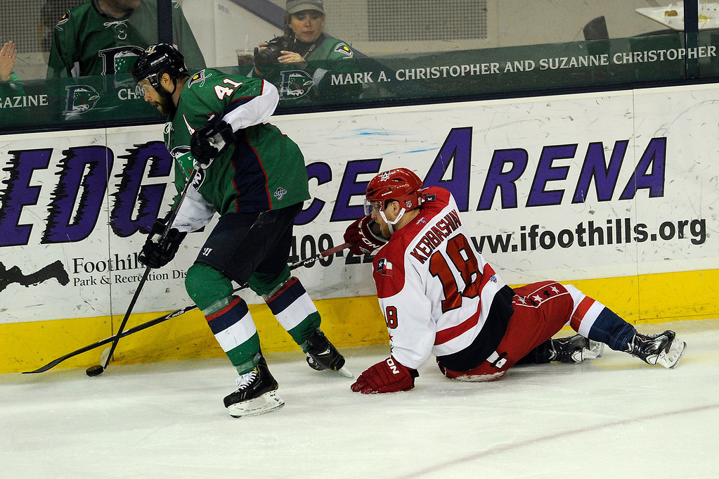 . DENVER, CO - MAY 2: Kale Kerbashian (18) of the Allen Americans attempts to poke check the puck away from Garett Bembridge (41) of the Denver Cutthroats during the second period of game 1 of the Ray Miron Presidents Cup Finals at the Denver Coliseum in Denver, Colorado on May 2, 2014. (Photo by Seth McConnell/The Denver Post)