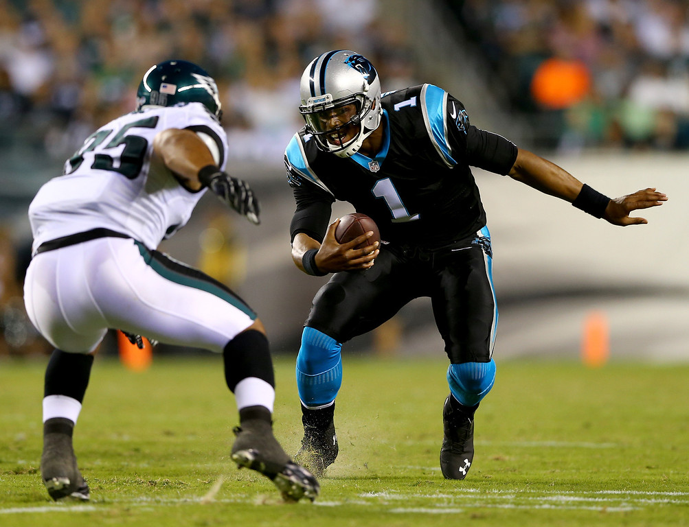 . PHILADELPHIA, PA - AUGUST 15:  Cam Newton #1 of the Carolina Panthers tries to get around Mychal Kendricks #95 of the Philadelphia Eagles on August 15, 2013 at Lincoln Financial Field in Philadelphia, Pennslyvania.  (Photo by Elsa/Getty Images)