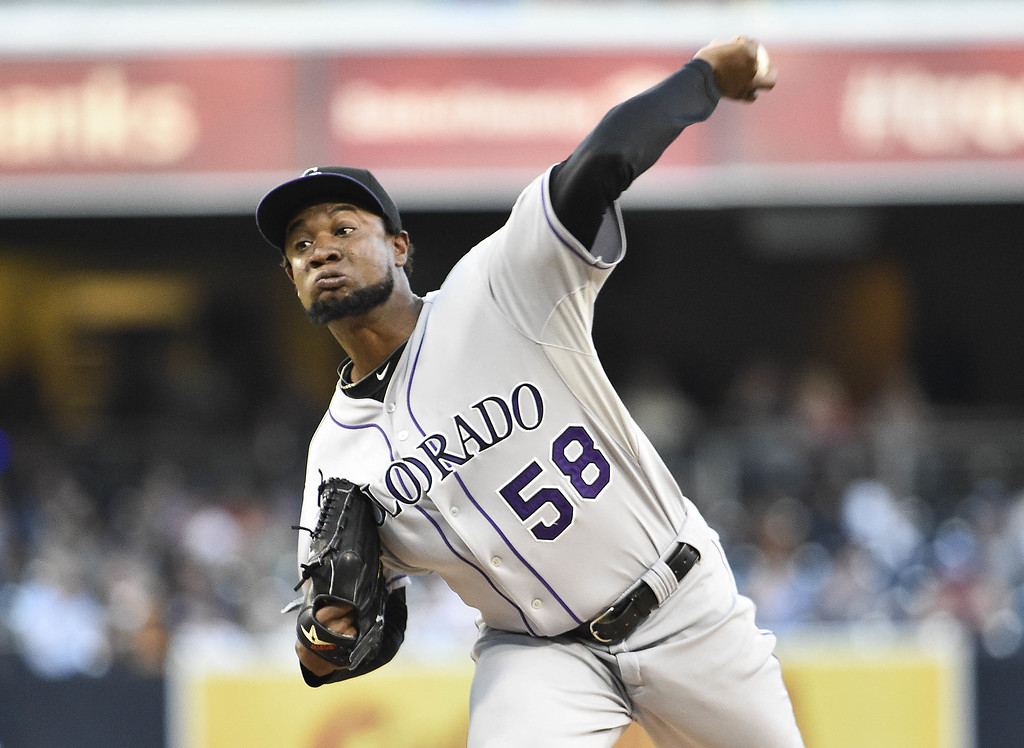 . SAN DIEGO, CA - SEPTEMBER 24:  Yohan Flande #58 of the Colorado Rockies pitches during the first inning of a baseball game against the San Diego Padres at Petco Park September, 24, 2014 in San Diego, California.  (Photo by Denis Poroy/Getty Images)