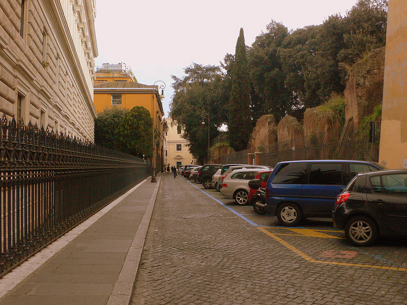 A small street off the Via Nazionale lined with roman ruins and government offices.