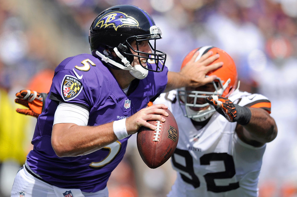 . Baltimore Ravens quarterback Joe Flacco (5) pushes off Cleveland Browns defensive end Desmond Bryant\'s helmet during the first half of a NFL football game in Baltimore, Md., Sunday Sept. 15, 2013. (AP Photo/Nick Wass)