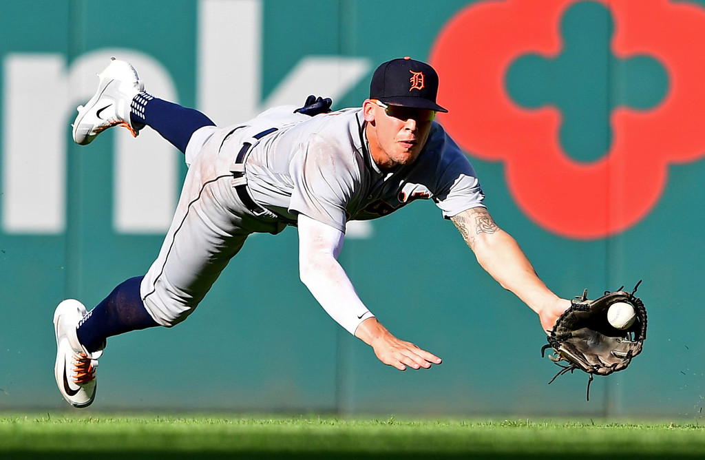 . Detroit Tigers\' JaCoby Jones dives for a ball hit by Cleveland Indians\' Yonder Alonso in the fourth inning of a baseball game, Saturday, Sept.15, 2018, in Cleveland. Alonso singled on the play. (AP Photo/David Dermer)