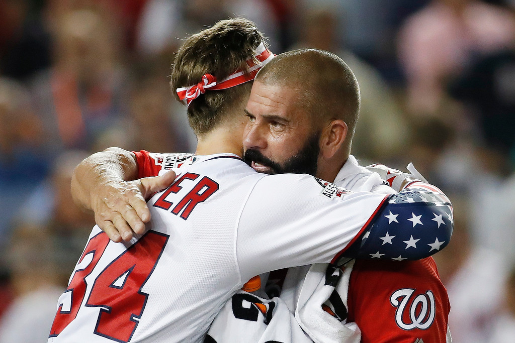 . Washington Nationals Bryce Harper (34) hugs his dad Ron Harper during the MLB Home Run Derby, at Nationals Park, Monday, July 16, 2018 in Washington. The 89th MLB baseball All-Star Game will be played Tuesday. (AP Photo/Alex Brandon)