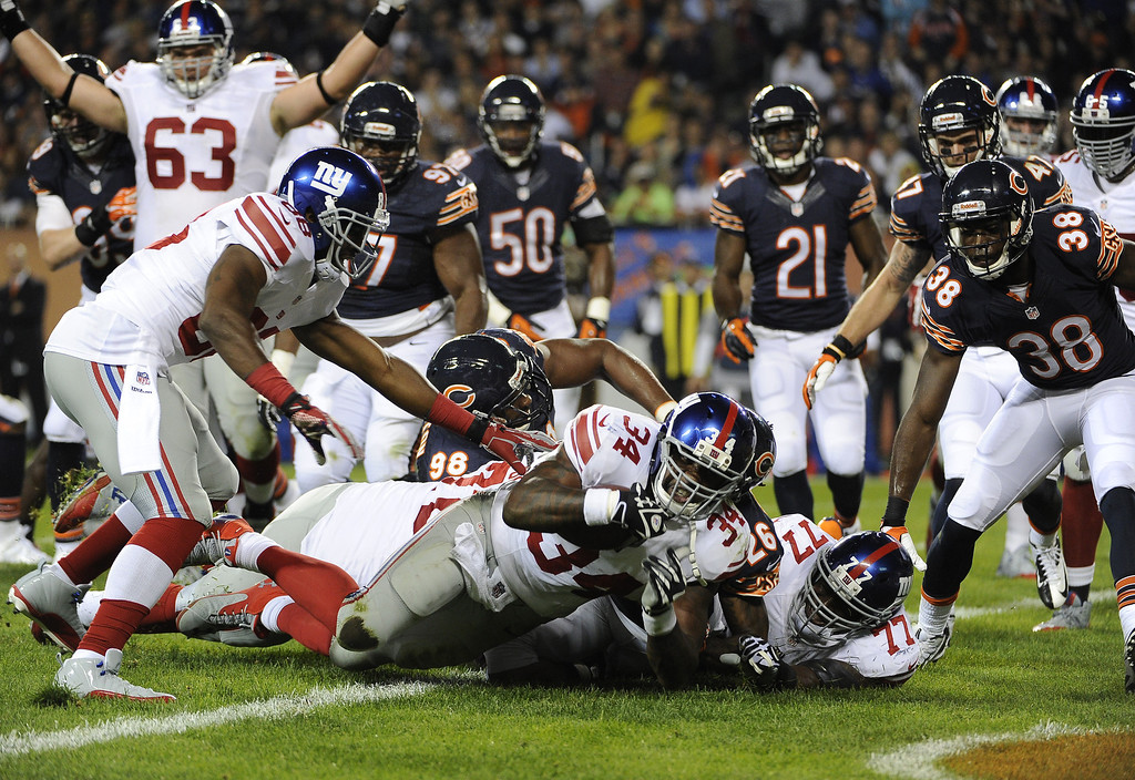 . Brandon Jacobs #34 of the New York Giants scores a touchdown against the Chicago Bears during the first quarter on October 10, 2013 at Soldier Field in Chicago, Illinois. (Photo by David Banks/Getty Images)