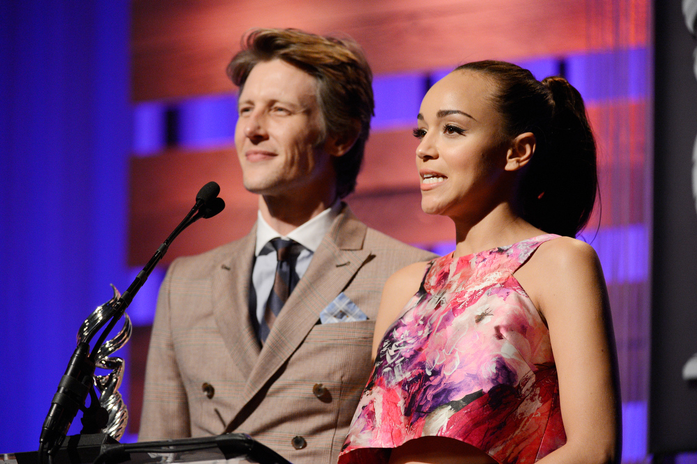 Description of . Presenters Gabriel Mann and Ashley Madekwe speak onstage during the 15th Annual Costume Designers Guild Awards with presenting sponsor Lacoste at The Beverly Hilton Hotel on February 19, 2013 in Beverly Hills, California.  (Photo by Frazer Harrison/Getty Images for CDG)