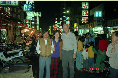 Another picture of Henry Fan and his wife walking Snake Alley in Taipei.