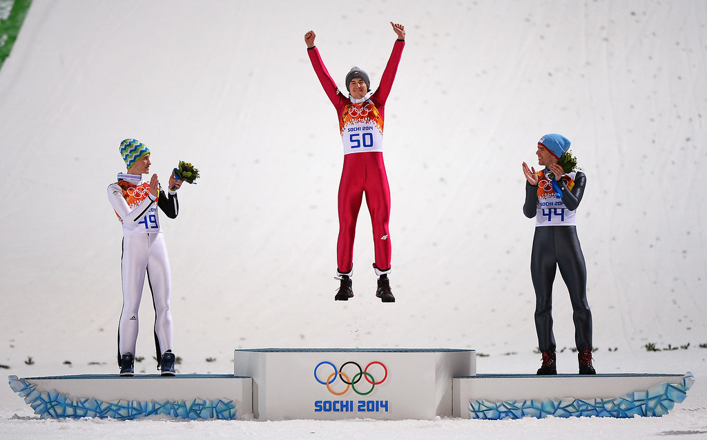 . SOCHI, RUSSIA - FEBRUARY 09:  (L-R) Silver medalist Peter Prevc of Slovenia, gold medalist Kamil Stoch of Poland and bronze medalist Anders Bardal of Norway celebrate on the podium during the flower ceremony for the Men\'s Normal Hill Individual Final on day 2 of the Sochi 2014 Winter Olympics at the RusSki Gorki Ski Jumping Center on February 9, 2014 in Sochi, Russia.  (Photo by Lars Baron/Getty Images)