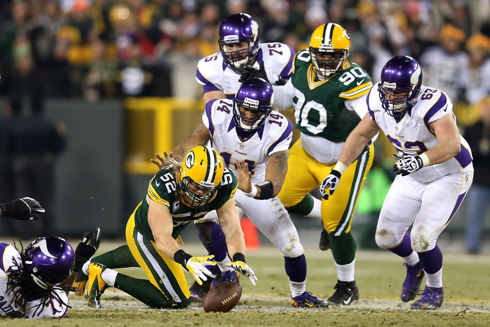 Description of . Linebacker Clay Matthews #52 of the Green Bay Packers recovers a forced fumble in front of quarterback Joe Webb #14 of the Minnesota Vikings in the second half during the NFC Wild Card Playoff game at Lambeau Field on January 5, 2013 in Green Bay, Wisconsin.  (Photo by Andy Lyons/Getty Images)