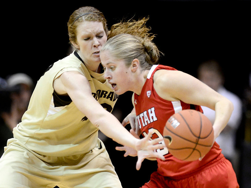 . Colorado\'s Rachel Hargis (left) bats the ball away from Utah\'s Rachel Messer (right) during their basketball game at the University of Colorado in Boulder , Colorado January 8, 2013. BOULDER DAILY CAMERA/ Mark Leffingwell