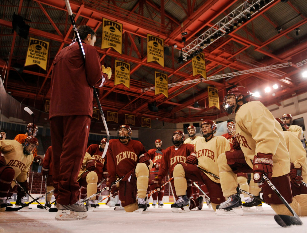 . Pioneers hockey coach George Gwozdecky brought the players together on the ice during practice Tuesday afternoon. The University of Denver Pioneers mens hockey team practiced at Magness Arena Tuesday afternoon, October 5, 2010.  Karl Gehring/The Denver Post