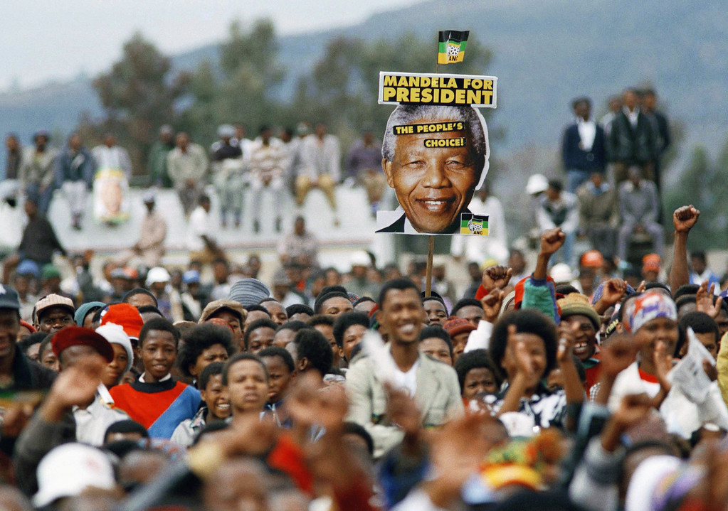 . Supporters of African National Congress President Nelson Mandela cheer and wave during an election rally at Thaba Nchu, South Africa, on Thursday, April 21, 1994, 240 miles (400kms) southwest of Johannesburg. South Africa�s first all race elections take place April 26-28 and Mandela is expected to win the country�s leadership. (AP Photo/David Brauchli)