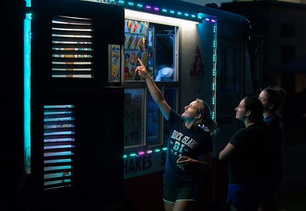 08/29/18 Wesley Bunnell | Staff Audra Veach, pointing, and her sisters Heather and Callie Veach look over the ice cream selection during a concert at Walnut Hill Park on Thursday night.