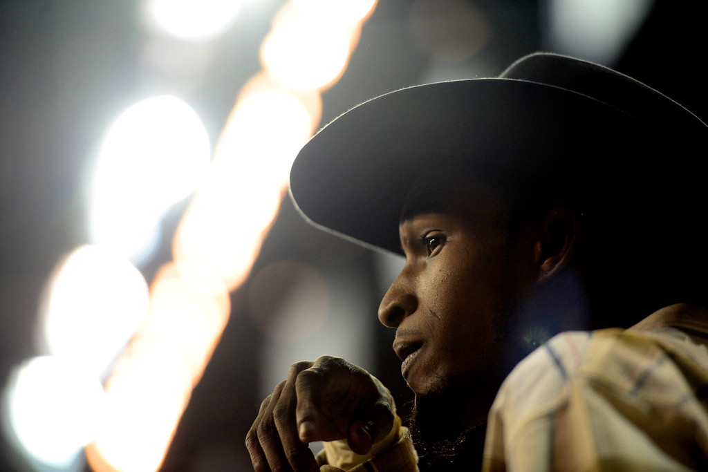 . DENVER, CO. - JANUARY 21:  Nelson Brewster watches fellow bull riders compete at the National Western Stock Show Martin Luther King Heritage Rodeo January 21, 2013 (Photo By AAron Ontiveroz / The Denver Post)